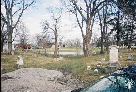 Image: di140092 - A view of the cemetery looking east from the west side of the cemetery.