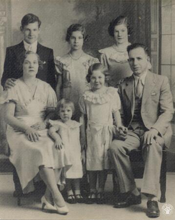 Image: di140141 - The Papas family in 1934. Left to Right Seated - Lillian, Joyce, Rita, and Chris. Standing - Alex, Gloria,....
