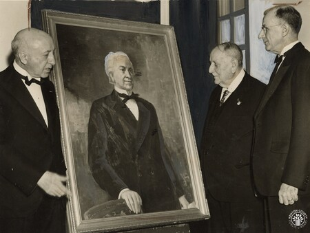 Image: di140387 - Edward A. Parsons, President of the Louisiana Historical Society, left, as he received an oil painting....
