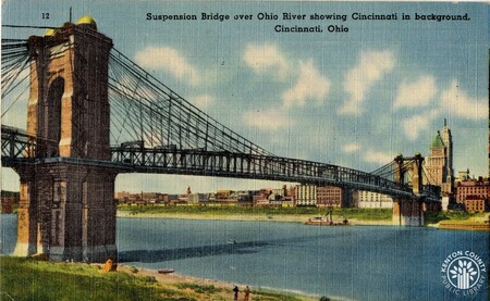 Image: di140445 - Postcard of Roebling Suspension bridge showing Ohio River and Cincinnati in the background.