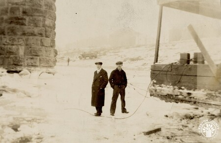 Image: di141017 - Photo of two unknown men - taken during the flood of 1937.