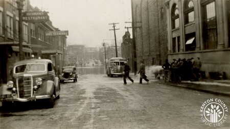 Image: di141027 - E. 6th St - Bank - during flood of 1937. Photo also shows Hickman's Restaurant and bus terminal.