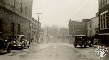 Image: di141035 - Pike and Scott Streets during the flood of 1937. John Hanauer Ford sign in the background.