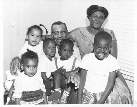 Image: di15287 - L-R: Cindy (2), Priscilla (3), Paul J. (2), Richard (2), Anthony (5) and Mr. and Mrs. Gisellie Baker
