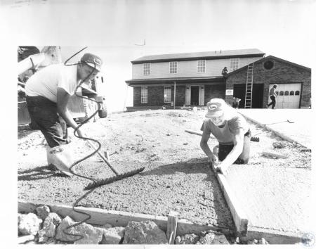 Image: di15913 - Ron Blair doing cement work on Homefest house