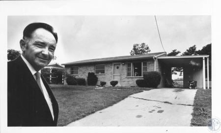 Image: di15916 - Charles W. Lantry and house he claims FHA appraised too low