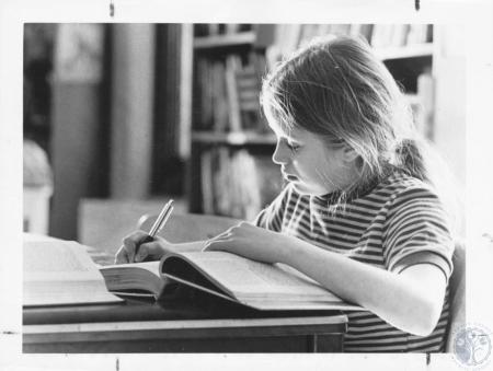 Image: di16362 - Debbie Johnson (11) takes notes from a book