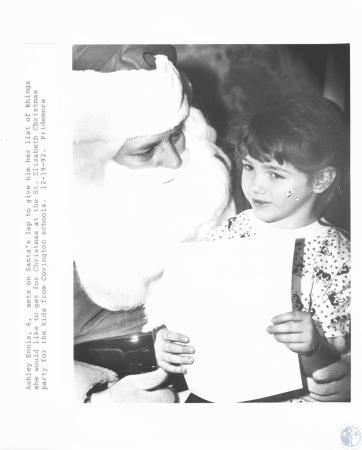 Image: di18584 - Emily Ennis (6) gives her list to Santa Claus
