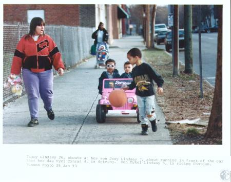 Image: di19476 - Tammy Lindsey (26) shouts at son joey (7) about running front of car daughter Nyci Conrad (4) is driving;....