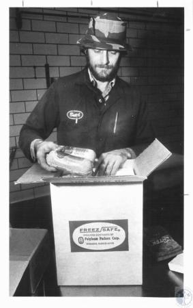 Image: di19514 - Butch Larison packs shipment of Glier's Goetta