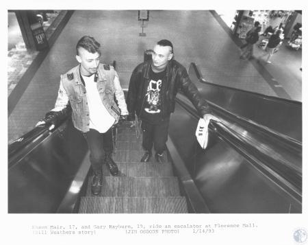 Image: di19644 - Shawn Mair (17) and Gary Rayburn (18) on escalator at Florence Mall