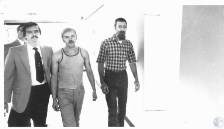 Image: di20385 - George Saylor (Deputy Sheriff), Jail Liason, Roanald Hensley and David Helvey who escaped from Campbell....
