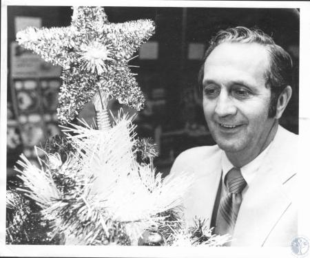 Image: di20388 - Don Schmidt of Kathman Paper Co., shows Christmas decoration