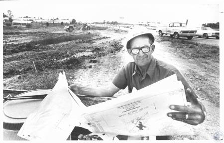 Image: di20554 - Elmer Schultz (53), Foreman with Harper Construction looking at ramp plans, with work on south ramp under....