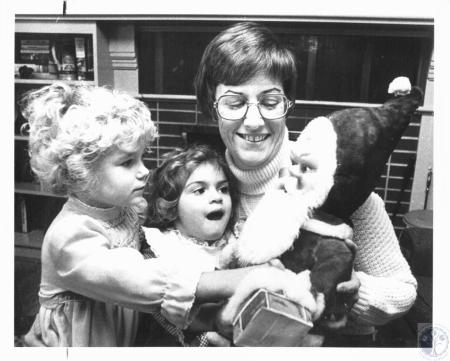 Image: di20688 - Jill Soete, Mindy Moellering, Mrs. James Becker with tiny Santa