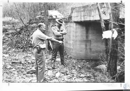 Image: di20712 - Deputy Sheriff Harold Wright and Tropper L. Booth at spot along New Hope Road where Cheryll Spegal's....