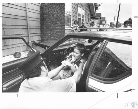 Image: di20884 - Fireman Al Angelini assists Cynthia Sprecker after crash at 16th and Jefferson