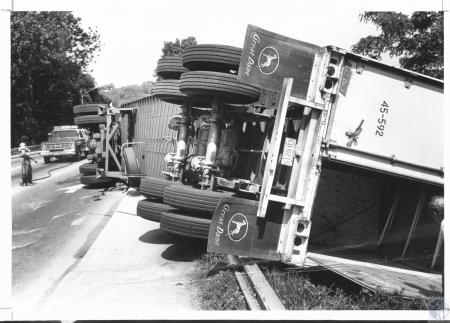 Image: di21948 - Beer and oil spilled form the wreckage of a tractor trailer driven by Leon McNure, Adrain GA when it....