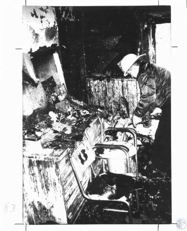 Image: di22217 - Carrollton Fire Chief Jack Miles (45) sifts through debris of a house fire that killed a Carrollton woman....