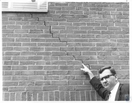 Image: di22298 - Bruce Hadley points to crack in new Victoria Square apartments
