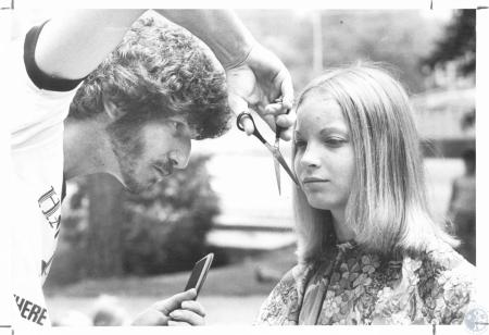 Image: di23232 - Doug Young, owner of hair styling shop, holds hair-a-thon to help youth, girl is Beth Schneider