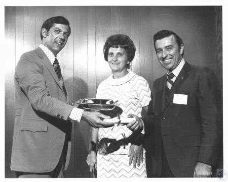Image: di23241 - W.B. Young, Mrs. Doc Doherty, Doc Doherty, winner in Standard Dealer contest