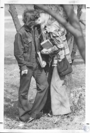 Image: di23289 - Tom Young (17) and Mary Jo Hill (17), standing by old tree in front of Holmes School