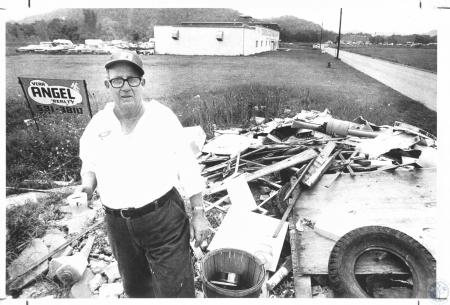 Image: di23502 - Paul Young, Covington Auto Body, at garbage pile
