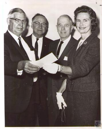 Image: di24022 - L to R: Rich Doran, Ray Hall, Edwin C. Heile, Mrs. John H. Edmiston; Mr. Doran donating profits to Diocesan....