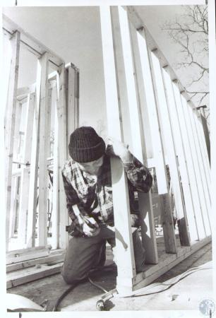 Image: di24176 - Dean Dillingham nailing down a section of studs for a wall in an apt. building under construction