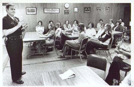 Image: di24299 - Capt Paul Eifert talking to police wives
