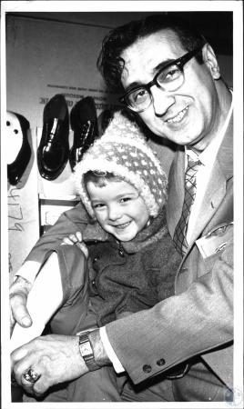 Image: di25127 - John Peluso and child (Paul Kunkel) receiving shoes from charity bingo.
