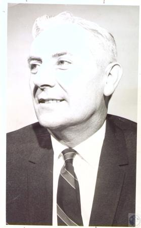 Image: di27027 - Ray E. Duncan - public relations director for Peoples Liberty Bank and Trust Company