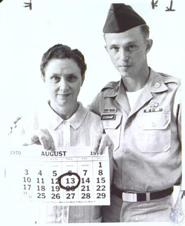Image: di27041 - Mrs. Audrey Exterkamp and son Thomas Exterkamp. Audrey is holding a calender that has August 13, 1970....