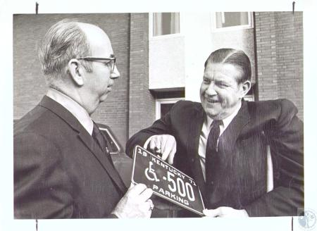 Image: di27213 - Al Wood and Carl Ruh with new handicapped automobile license plate