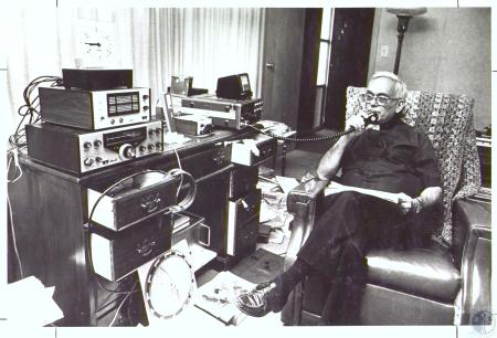 Image: di27216 - Rev. Paul P. Ciangetti with amateur radio setup in rectory of Mary Queen of Heaven Church