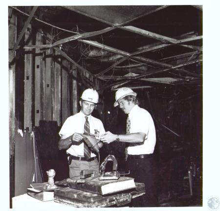 Image: di27229 - installation foreman Jess Laws and accounts manager Ron Ott examine fire damaged desk in second floor....