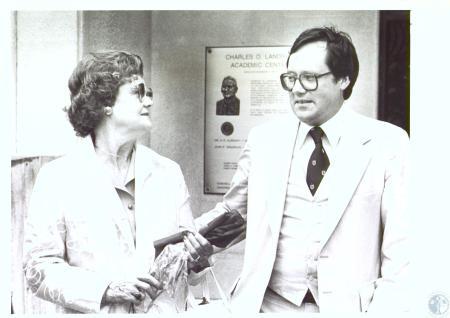 Image: di27248 - Mrs. Roberta Landrum and John Demarcus - in background is plaque dedicating Landrum Academic Center to....