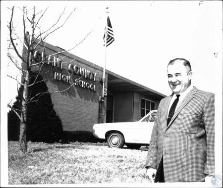 Image: di27559 - Principal Leo Brewsaugh in front of Grant Co. High School original building