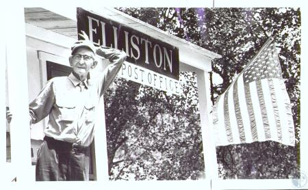 Image: di29015 - Adrian Beach (73) standing on front porch of Elliston Post Office
