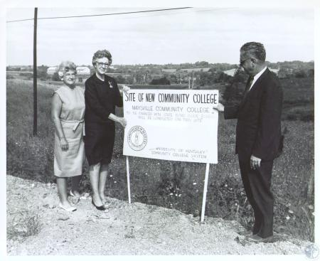 Image: di29914 - Mrs. Charles Calvert Jr., Mrs. Martha Comer and J. Frank Jones at 75 acre site for Maysville Community....