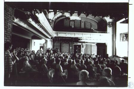 Image: di29996 - Audience at theater in Carnegie Art Center. Notice people sitting on folding chairs, missing plaster,....