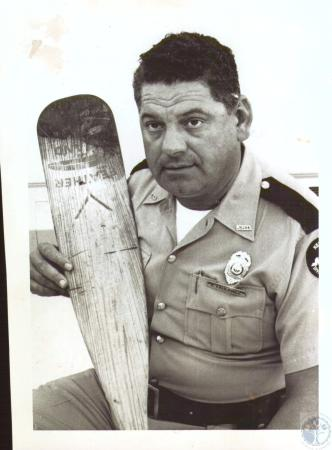 Image: di31210 - Eldred Faulkner, KY River Police, with paddle used as evidence in river littering case