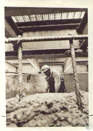 Image: di31213 - John White, Schweiter Construction Company, at work under Suspension Bridge