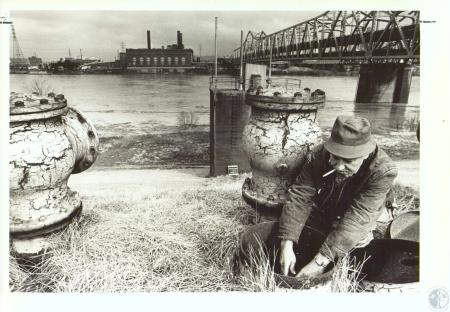 Image: di31251 - Fireman Charles White starts floodwall pump at Willow Run in Covington