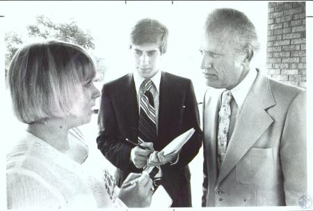 Image: di31460 - Peter Barnes (center) and Gov. Julian Carroll with unidentified woman.