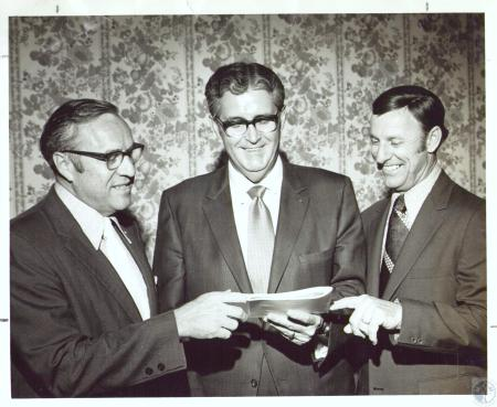 Image: di31520 - Vic Fender, past president, Harry Lowe, president, Ronald B. Jones, district governor or Rotary at swearing....