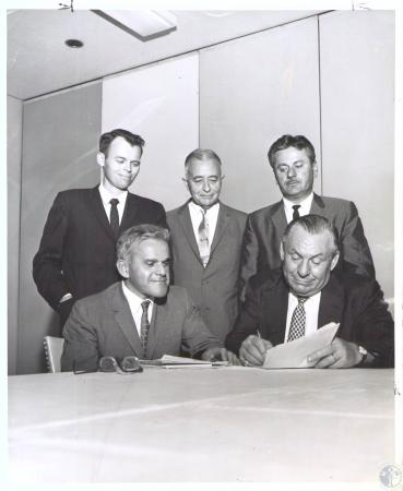 Image: di32366 - Officials of ACME Steel company and United Steel Workers of America sign labor contract. Left to Right,....