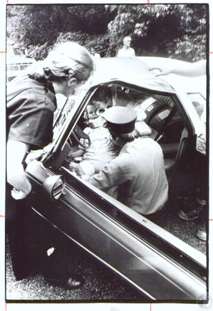 Image: di32854 - Crash victim Eunice Walker (35) is getting collar to neck by Ft. Wright Life Squad