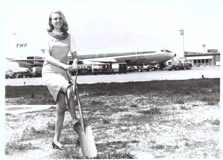 Image: di32907 - Debbie Bolan with spade used in original groundbreaking May 3, 1943